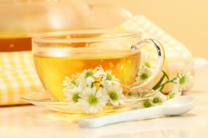 Glass-tea-cup-with-herbal-tea-and-flowers